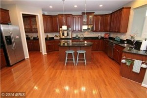 The beautiful, open kitchen in Courtland Village Drive!