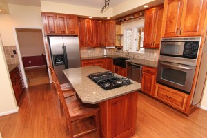 Beautiful remodeled kitchen with custom cherry cabinets