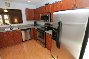 The updated kitchen (complete with stainless steel appliances) at Pebble Brook Court!